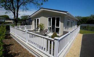 Gorgeous White uPVC Hampton Decking installed by The Mayfield Group UK for Static Caravans