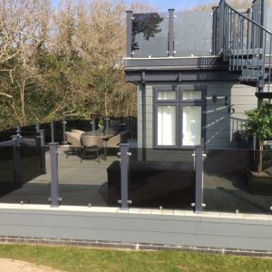 upvc hampton decking with clearview balustrades