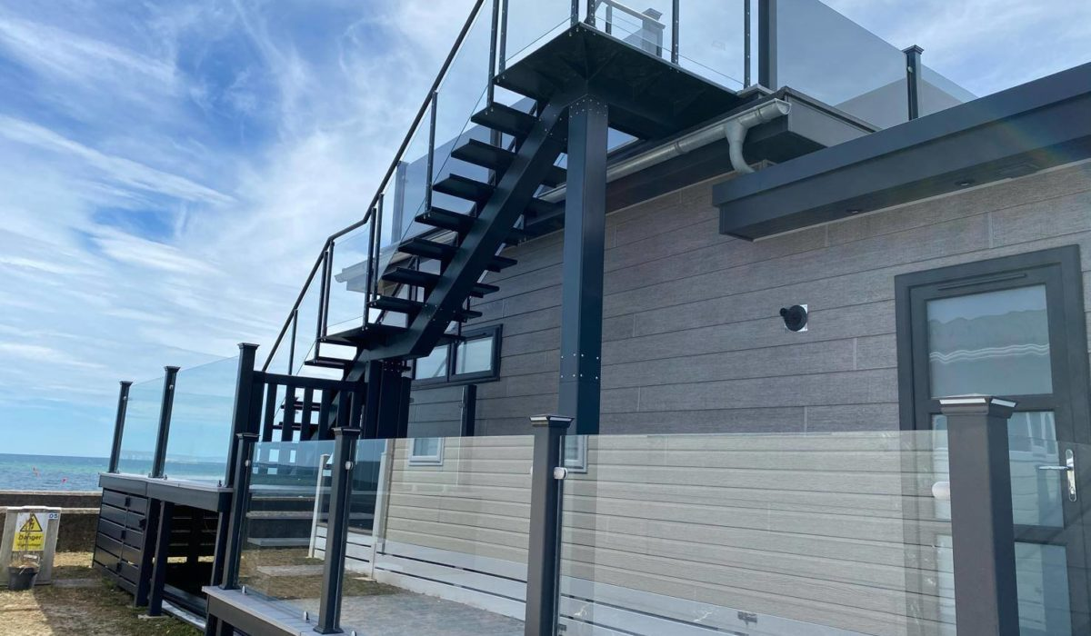 A two-storey sundeck with bespoke stairs by The Mayfield Group