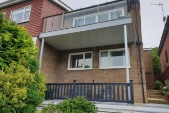 Double storey residential deck with Hampton Decking boards and glass balustrades